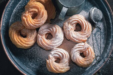 Sweet and fresh spanish donuts with powdered sugar
