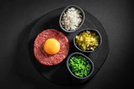 Enjoy your beef tartare with chives, gherkin and yolk 写真素材