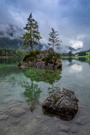 Rocks in mountain lake Hintersee in Berchtesgaden national park 写真素材