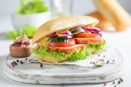 Savory sandwich with roasted pork neck, cucumber and onion