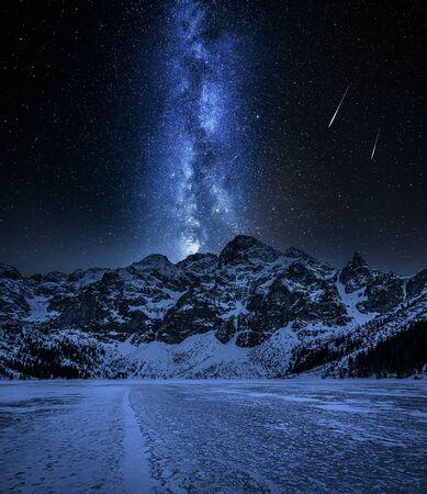 Snowy Morskie Oko mountain lake in winter at night Фото со стока