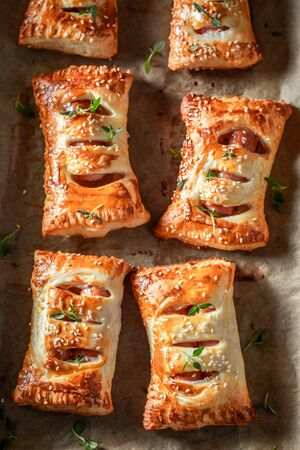 Top down view of sausage in puff pastry with herbs