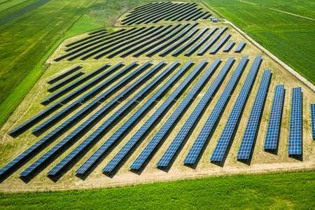 Aerial view of solar panels on green field, Poland Zdjęcie Seryjne