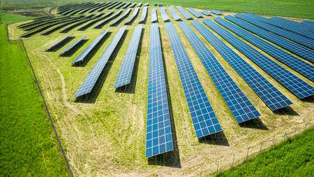 Stunning view of solar panels on green field in summer