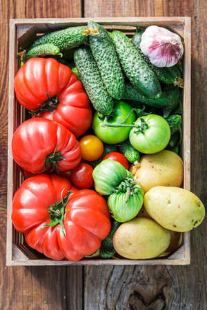 Fresh and tasty vegetables in wooden box