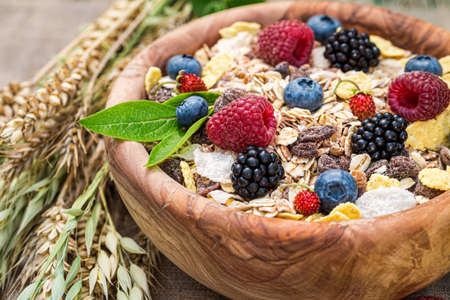 Closeup of granola with milk and fresh berries