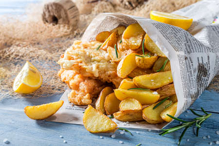 Fish cod with chips and lemon in newspaper 版權商用圖片
