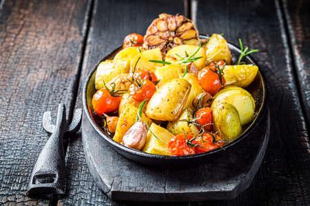 Roasted potato with fresh tomatoes, potatoes and garlic