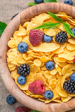 Top view of cornflakes fresh berry fruits