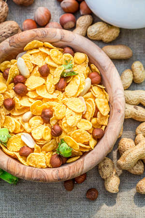 Tasty and healthy cornflakes with fresh hazelnuts