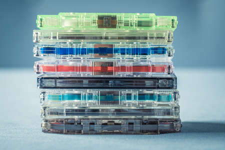 Closeup of old pile of cassette tapes on blue sofa
