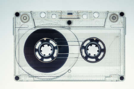 Closeup of retro transparent one audio cassette on white background