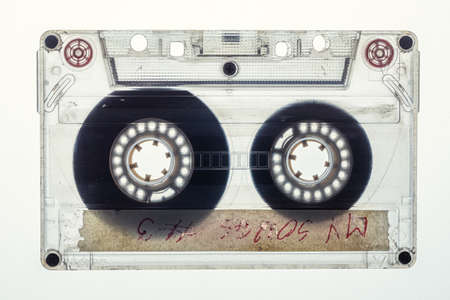Closeup of vintage one transparent audio cassette on white background Standard-Bild