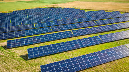 Aerial view of solar panels on green field in Poland, Europe