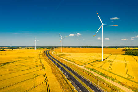 Golden field, highway and wind turbines, aerial view, Poland Banco de Imagens