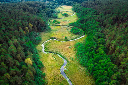Small winding river in autumn, aerial view, Poland
