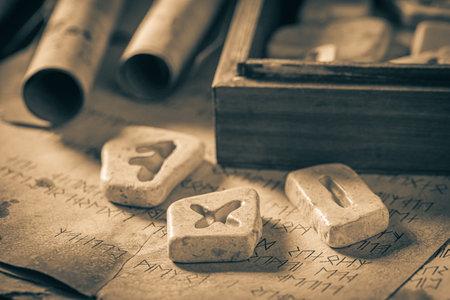 Closeup of runestones and ancient scrolls with futhark language Stock Photo