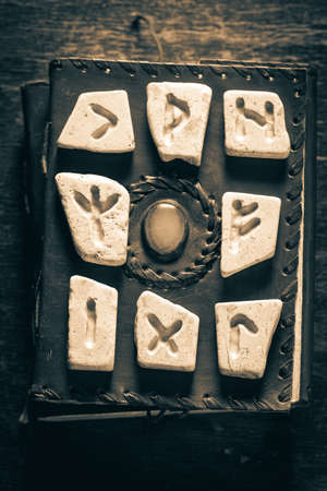 Unique divination by rune stones using Celtic language on old book