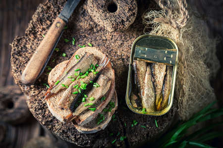 Fresh and delicious sardines sandwich with with chive on wooden board