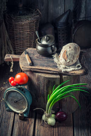 Old and wooden cellar with preserves in jars and vegetables Stok Fotoğraf