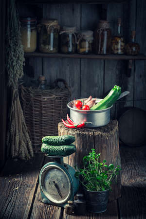 Old and wooden hut with vegetables and fresh herbs