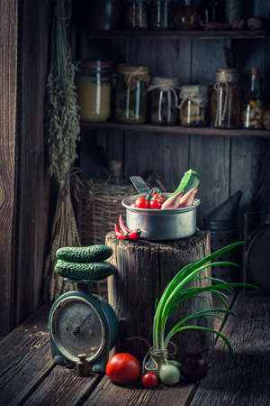 Wooden and old cellar with vegetables and preserves in jars