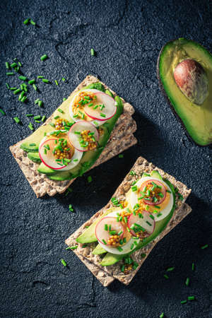 Top view of crisp and healthy sandwich with eggs and avocado