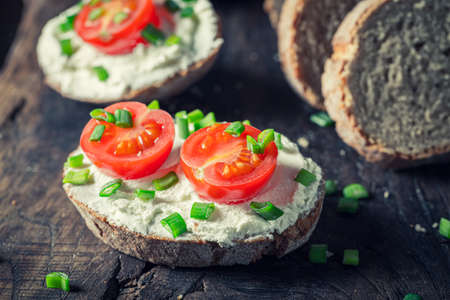 Closeup of healthy sandwich with fromage cheese and tomatoes 版權商用圖片