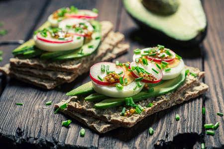 Tasty and homemade sandwich with eggs, avocado and radish 版權商用圖片