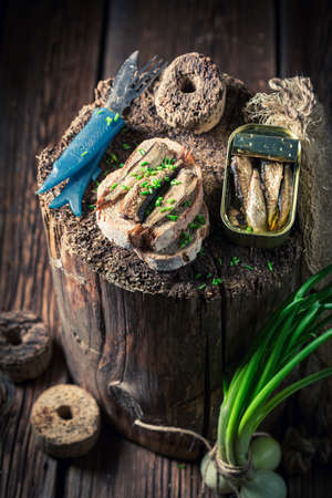 Tasty and homemade sardines sandwich with on the wholegrain bread on wooden board