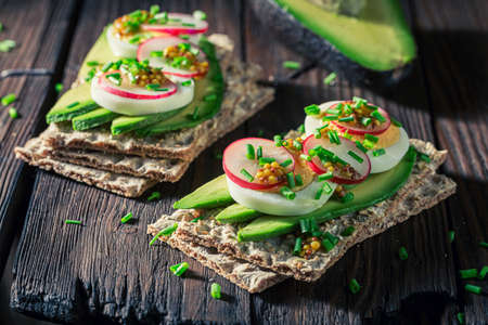 Closeup of healthy sandwich with avocado and radish