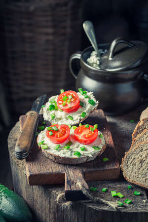 Closeup of sandwich with fromage cheese, cherry tomatoes and chive