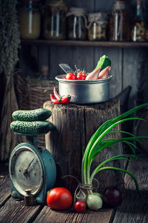 Retro and wooden cellar with canned food and vegetables