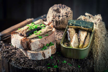 Healthy and fresh sardines sandwich with on the wholegrain bread on wooden board