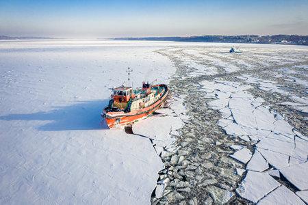 Icebreakers on the Vistula River crushing ice near Plock, 2020-02-18, aerial view