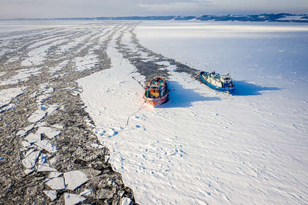 Two icebreakers crush the ice on Vistula river, 2020-02-18, Poland, aerial view