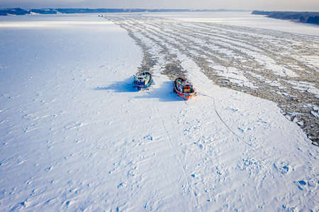 Two icebreakers crush the ice near Plock, 2020-02-18, Poland, aerial view