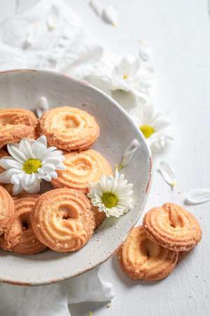 Delicious round butter cookies as crunchy and vanilla snack on white table