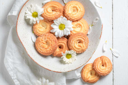 Tasty danish cookies made of butter and sugar on white table