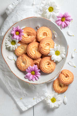 Homemade round butter cookies as crunchy and vanilla snack on white table