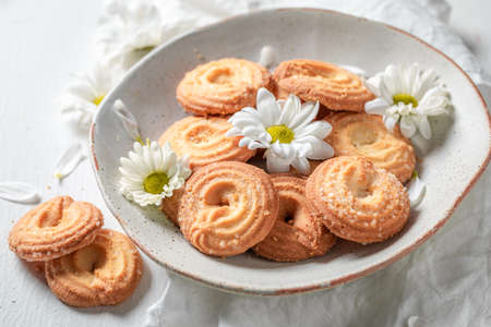 Sweet round butter cookies as crunchy and vanilla snack on white table Stok Fotoğraf