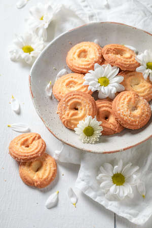 Delicious round butter cookies made of butter and sugar on white table