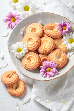 Homemade danish cookies made of butter and sugar on white table