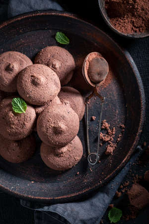 Delicious dark chocolate cookies made of cocoa, butter and sugar on dark table Stok Fotoğraf