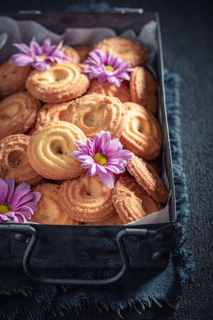 Delicious danish cookies in an ceramic plate on dark table Stok Fotoğraf