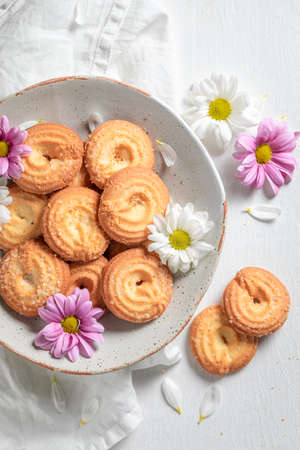 Sweet danish cookies as crunchy and vanilla snack on white table
