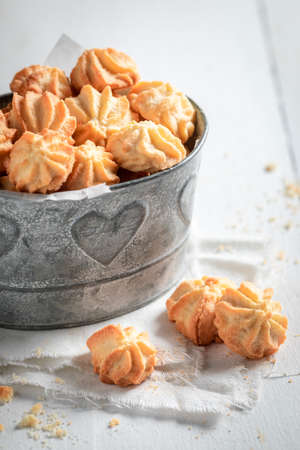 Delicious shortbread cookies in old metal bucket on white table Stok Fotoğraf