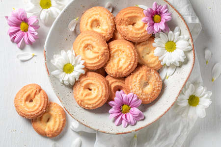 Sweet round butter cookies made of butter and sugar on white table