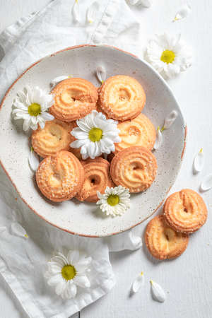Delicious danish cookies made of butter and sugar on white table