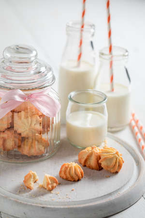 Shortbread cookies made of butter, sugar and milk on white table